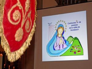 De la bannière traditionnelle au logo de la nouvelle «Communauté de Paroisses de la Vallée de Hundsbach»